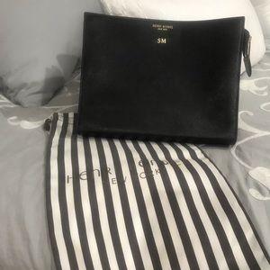 Henri Bendel black makeup bag/clutch